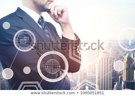üzletember néz virtuális felhő hologram üzletemberek Stock fotó © dolgachov