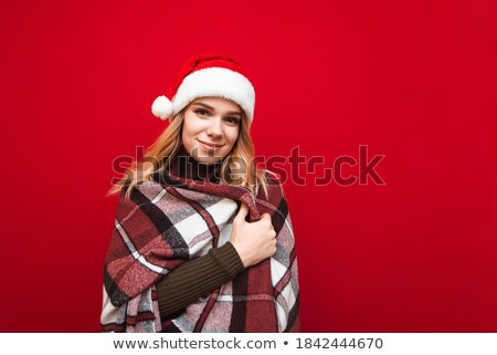 Thoughtful girl standing isolated wearing christmas santa hat. Stock photo © deandrobot