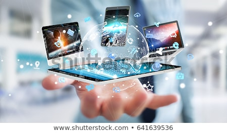 businessman with tablet pc and network hologram Stock photo © dolgachov