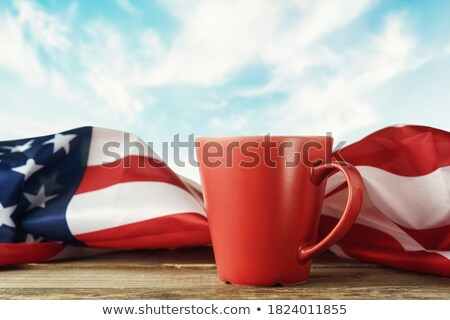 Red flag with a wooden handle Stock photo © sidmay