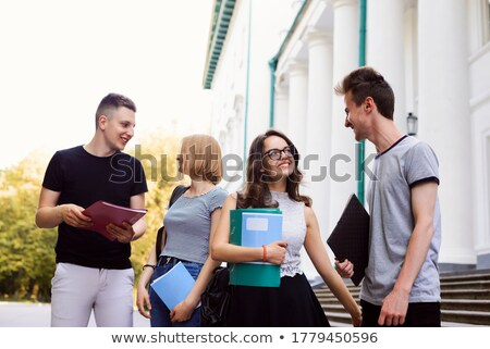 Teenage couple flirting near a tree Stock photo © IS2