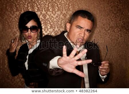 Vrouw verbergen paparazzi hand vrouwelijke zonnebril Stockfoto © IS2