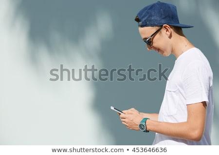 Fiú küldés szöveges üzenet osztályterem profil férfi Stock fotó © IS2