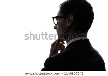 Atraente sério empresário óculos olhando lado Foto stock © feedough