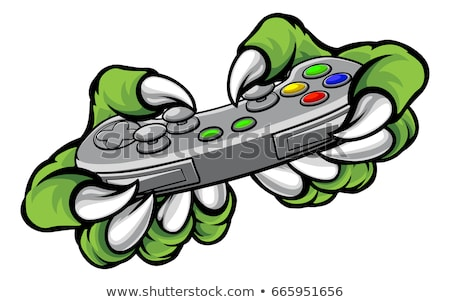 Foto stock: Monster Gamer Claws Holding Games Controller