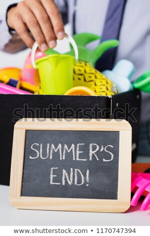 man storing summer stuff and text summers end Stock photo © nito