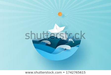 Illustration of sea view with dolphin and clouds. Paper cut and craft style. Summer background with  Stock photo © olehsvetiukha