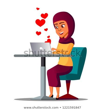 Posiedzenia Emiraty dziewczyna laptop serca pływające Zdjęcia stock © pikepicture