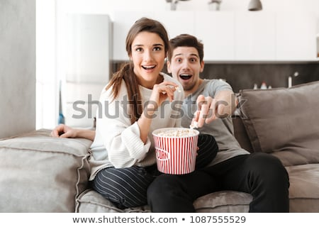 Man Eating Popcorn While Watching Television Stock photo © AndreyPopov