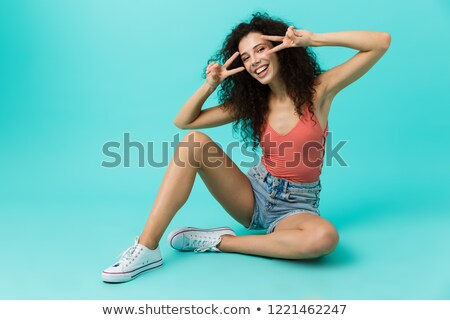 Image of european woman 20s wearing casual clothing smiling whil Stock photo © deandrobot