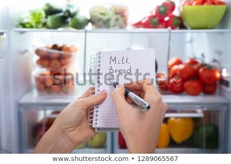 Kadın yazı spiral notepad buzdolabı Stok fotoğraf © AndreyPopov