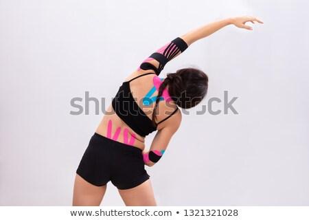 女性 ストレッチング 腕 テープ 戻る クローズアップ ストックフォト © AndreyPopov