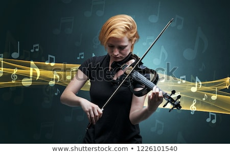 Músico jogar violino notas em torno de jovem Foto stock © ra2studio