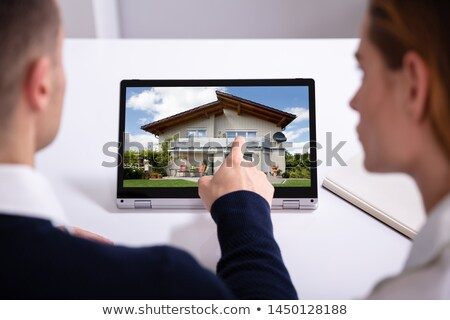 Estate Agent's Hand Pointing Laptop Screen Showing House Model Stock photo © AndreyPopov