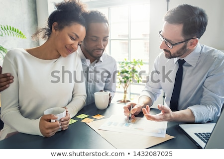 young couple meeting with a banker for a home loan real estate stock photo © freedomz