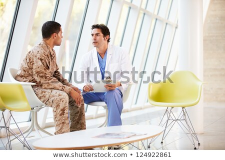 doctor counseling soldier suffering from stress stock photo © andreypopov