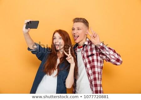 Paar mobiele portret glimlachend Stockfoto © Kzenon