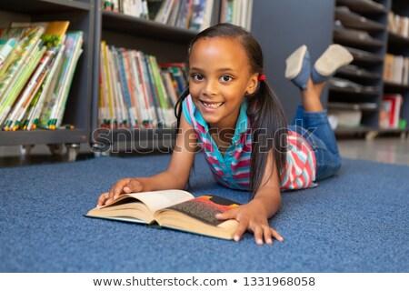 özenli · öğrenci · eğitim · kütüphane · okul · kitap - stok fotoğraf © wavebreak_media