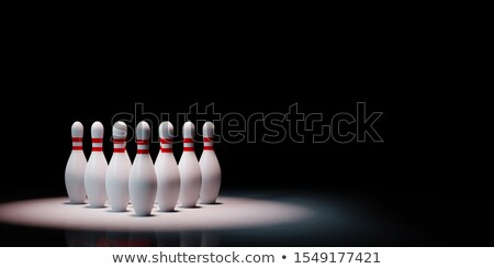 Bowling Skittles Spotlighted on Black Background Stock photo © make