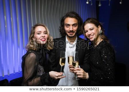 Genç takım elbise ayakta iki güzel kızlar Stok fotoğraf © pressmaster