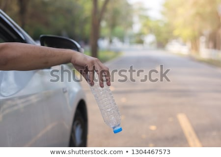 man throwing a plastic bottle to the trash bin Stock photo © nito