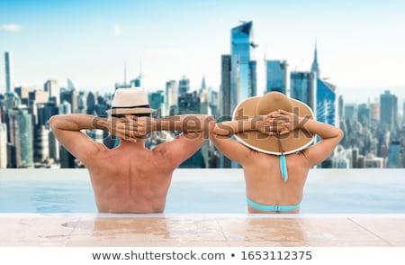 Casal infinito piscina Dubai linha do horizonte mulher Foto stock © AndreyPopov