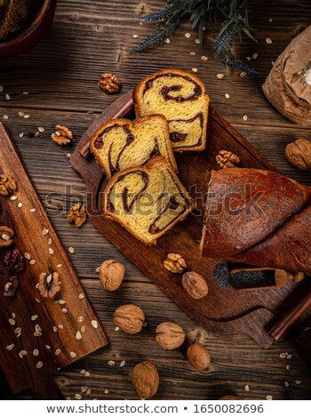 Flat lay of brioche style sweet loaf with walnuts Stock photo © grafvision