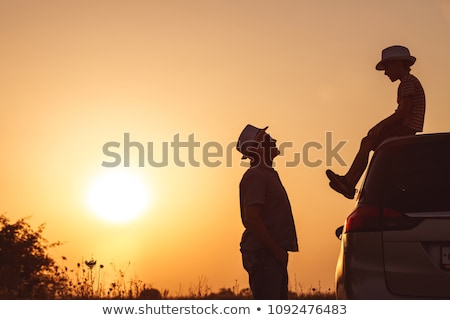 Father and son walking on the road at the day time.  Stock photo © altanaka