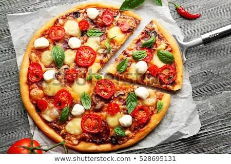 пиццы · Ломтики · деревянный · стол · продовольствие · домой - Сток-фото © pancaketom