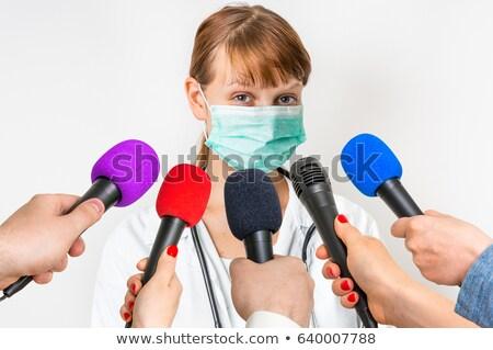 Surgeon speaking recording Stock photo © lovleah