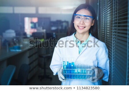Closeup of woman analysing test tube Stock photo © lovleah