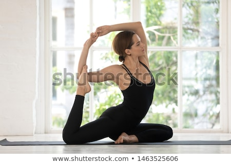 Fit Slim Woman Practising Yoga Stock photo © rognar