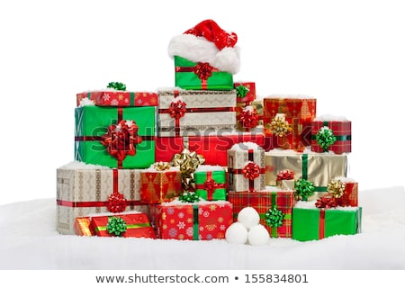 Christmas present with Santa's hat against red background Stock photo © AndreyKr