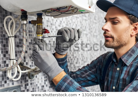 a workman working with a plumb Stock photo © photography33