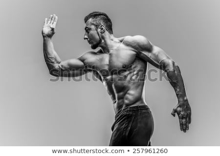 強健的身體 英俊 健美 天空 性感的 運動 商業照片 © konradbak