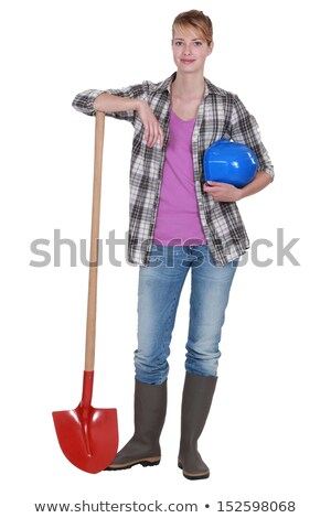 Potrait of a tradeswoman with her shovel Stock photo © photography33