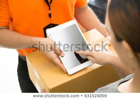Courier with a signed for delivery Stock photo © photography33