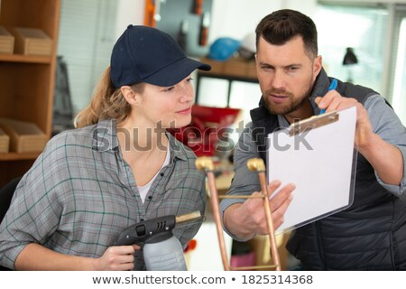 woman cutting copper pipe stock photo © photography33