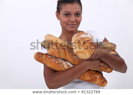 young black woman holding a lot of bread in her arms Stock photo © photography33
