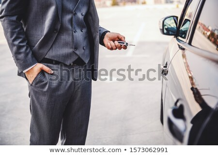A cropped picture of a businessman handing a key. Stock photo © photography33