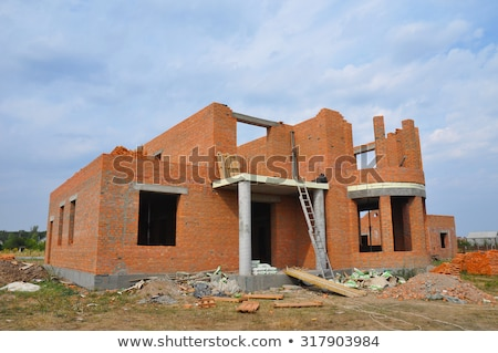 Roofer working on unfinished house Stock photo © photography33