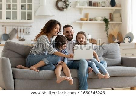 boldog · család · játszik · együtt · laptop · kanapé · nő - stock fotó © wavebreak_media