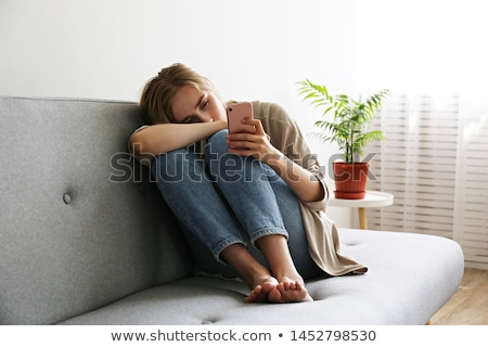 Mulher jovem deprimido sessão cadeira choro mulher Foto stock © rosipro