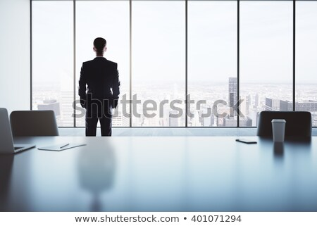Reflective business man with a white mug Stock photo © pablocalvog