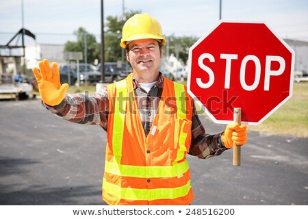 worker holding up road sign stock photo © photography33