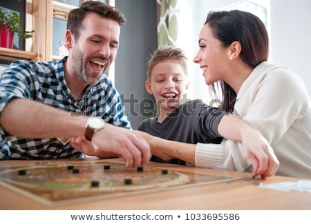 Stockfoto: Family Playing A Board Game Together