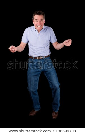 Funny Middle Age Man Dancing with Cheesy Grin Stock photo © scheriton