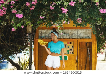 Beautiful happy woman at old fashioned gas station Stock photo © dashapetrenko