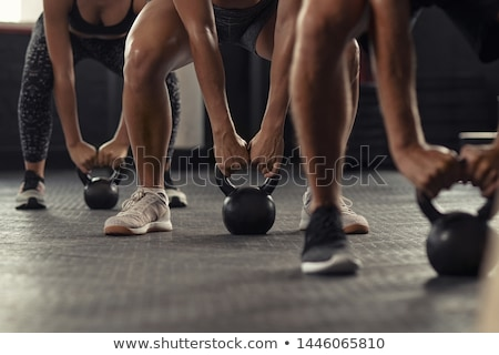 Young man Lifting Crossfit Kettle Bell Stock photo © dacasdo