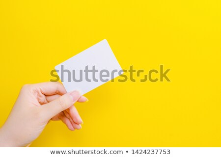 hand holding a yellow card Stock photo © Nelosa